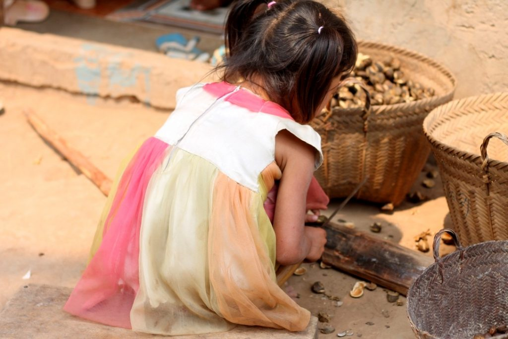 Girl working in Ban Baw village