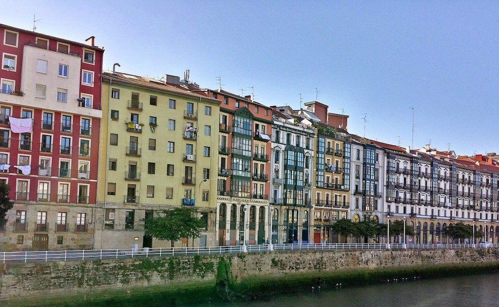 bilbao travel guide colourful riverside buildings