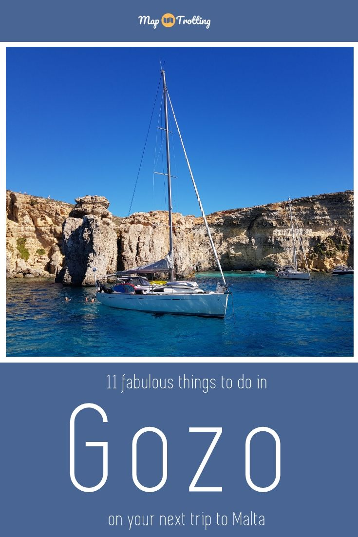 A white yacht moored in the blue waters of the Crystal Lagoon - sailing is one of the ways to experience Gozo.
